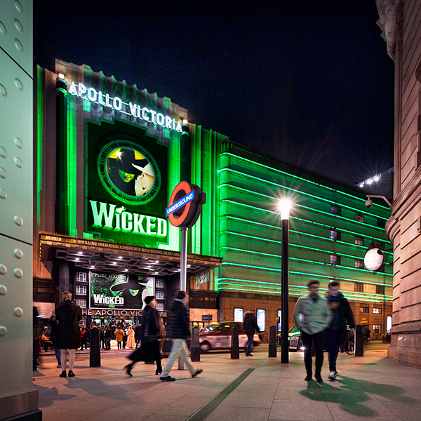 Wicked at the Apollo Victoria Theatre external imagery at night